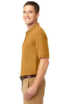 Gold Port Authority Silk Touch Polo as seen from the sleeveleft