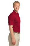 Rich Red Port Authority Tech Pique Polo as seen from the sleeveright