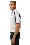 White Black Port Authority Silk Touch Performance Colorblock Stripe Polo as seen from the sleeveleft