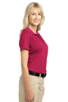 Raspberry Pink Port Authority Ladies Tech Pique Polo as seen from the sleeveright