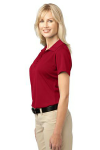 Rich Red Port Authority Ladies Tech Pique Polo as seen from the sleeveleft