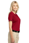 Rich Red Port Authority Ladies Tech Pique Polo as seen from the sleeveright