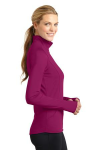 Pink Rush Sport-Tek Ladies Sport-Wick Stretch 1/2-Zip Pullover as seen from the sleeveright