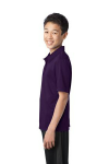 Bright Purple Port Authority Youth Silk Touch Performance Polo as seen from the sleeveleft