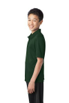 Dark Green Port Authority Youth Silk Touch Performance Polo as seen from the sleeveleft