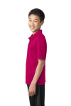 Pink Raspberry Port Authority Youth Silk Touch Performance Polo as seen from the sleeveleft