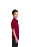 Red Port Authority Youth Silk Touch Performance Polo as seen from the sleeveright