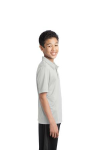White Port Authority Youth Silk Touch Performance Polo as seen from the sleeveright