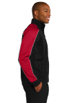 Blk Tr Red Wht Sport-Tek Piped Tricot Track Jacket as seen from the sleeveleft