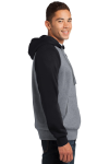 Black Vnt Hthr Sport-Tek Raglan Colorblock Pullover Hooded Sweatshirt as seen from the sleeveleft