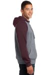 Maroon Vnt He Sport-Tek Raglan Colorblock Pullover Hooded Sweatshirt as seen from the sleeveleft